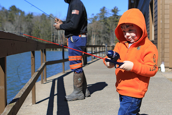 Easton Wriston, 3, of Beckley, fishes with his dad at Little Beaver State Park Wednesday. (Jenny Harnish/The Register-Herald)