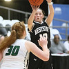 (Brad Davis/The Register-Herald) Westside's Makayla Morgan shoots from three-point range as Wyoming East's Sarah Saunders defends during Friday action at the New River Community and Technical College Shootout at the Beckley-Raleigh County Convention Center.