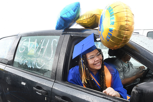 Aaliyn Painter, waits to receive her diploma in her car during Greenbrier West High School graduation ceremony Friday evening  held at the State Fair of West Virginia's free parking lot in Fairlea. <br /> (Rick Barbero/The Register-Herald)