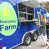 Jennifer Linkfield and her daughter Ava Linkfield, 11, of Hico, gets a take out order  Riverchick Food Truck on located on 43 Hopewell Road in Victor.<br /> (Rick Barbero/The Register-Herald)