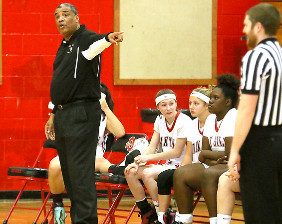 (Brad Davis/The Register-Herald) Oak Hill head coach Marshall Murray instructs his team against Wyoming East Thursday night in Oak Hill.