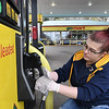 Lauren Diciucco, cleans all the pumps at GoMart off of route 19 in Mt. Hope to help prevent germs due to COVID-19.<br /> (Rick Barbero/The Register-Herald)