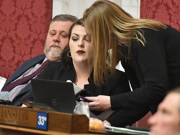 (Brad Davis/The Register-Herald) Delegate Kayla Kessinger (R-Fayette) works through a night session in the House during the final day of the state's regular legislative session Saturday in Charleston.