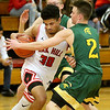 (Brad Davis/The Register-Herald) Oak Hill's Darian McDowell is pressured by Greenbrier East's Tucker Via, right, and Adam Seams at mid-court Wednesday night in Oak Hill.
