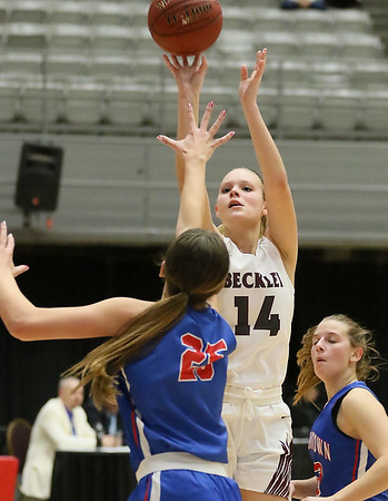 (Brad Davis/The Register-Herald) Woodrow Wilson's Olivia Zolkowski shoots as Morgantown's Kaitlyn Ammons defends during Big Atlantic Classic action Thursday night at the Beckley-Raleigh County Convention Center.