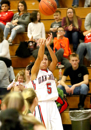 (Brad Davis/The Register-Herald) Oak Hill's Samiah Lynch shoots from three-point range against Wyoming East Thursday night in Oak Hill.
