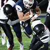 Atticus Goodson, of Independence, get tackled by Liberty defenders during first half action at Independence High School Friday, October 2.<br /> (Rick Barbero/The Register-Herald)