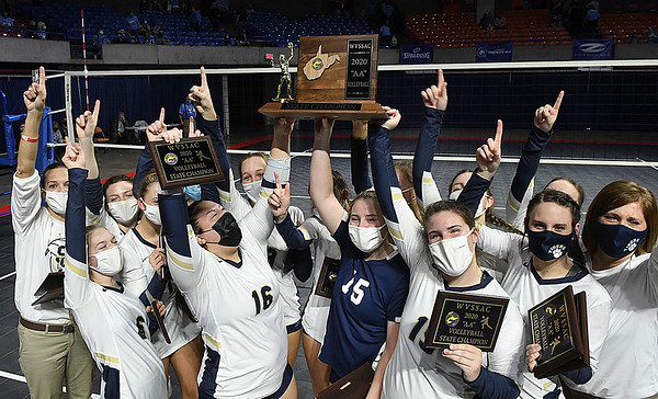 Shady Spring celebrates after winning the state championshion against Phillips Barbour in the Class AA girls volleyball tournament in Charleston Friday evening.<br /> (Rick Barbero/The Register-Herald)