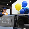 Colton Wiseman waits at his parents car to receive his diploma during Shady Springs graduation Ceremony. Due to the COVID-19 global pandemic, students at Shady Spring High School were not able to take part in the traditional graduation ceremony like students in the past, but their administration made accommodations so their parents and family members could watch them walk across the stage, receive their diplomas, and turn their tassels Friday evening in front of the school.<br /> (Rick Barbero/The Register-Herald)