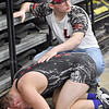 (Brad Davis/The Register-Herald) Liberty wrestler Billy Stoots tries to console brother Davy after losing his match in the 152-pound bracket to Liberty Harrison's Bryce Steams Friday afternoon at the 73rd Annual State Wrestling Tournament in Huntington.