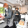 Phillip Culicerto, owner, left, and his niece Ellie Culicerto, prepares food in his new business Philipo's Food Trailer  in the Parking lot of United Way of Southern WV. (Rick Barbero/The Register-Herald)