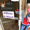 Virginia Butcher, executive president Appraisal Resource Center on 207 South Heber Street in Beckley. Displays her sign that was given to her by Michelle Rotellini, President CEO, Beckley-Raleigh County Chamber of Commerce. The Chamber partnered with Dr. Ayne Amjad on her hashtag campaign, #Wear A Mask.  Dr. Amjad asked the Chamber to help promote #Wear A Mask to keep our community safe. The Chamber will be delivering window signs for businesses with the hashtag #Wear A Mask displayed in bold purple.  To receive a window sign for your business, please email Chamber@Brccc.com or call 304.252.7328.<br /> (Rick Barbero/The Register-Herald)