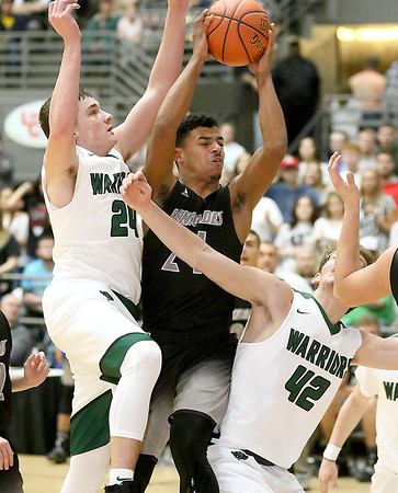 (Brad Davis/The Register-Herald) Westside's Jace Colucci drives hard to the basket as Wyoming East's Tanner Whitten, left, and Anthony Martin defend during the New River Community and Technical College Shootout Saturday at the Beckley-Raleigh County Convention Center.