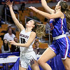 (Brad Davis/The Register-Herald) Woodrow Wilson's Cloey Frantz drives and scores as Morgantown's Kaitlyn Ammons defends during  Girls State Basketball Tournament Wednesday afternoon in Charleston.