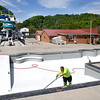 Dale Starks, of the City of Hinton, cleaning the surface of the city's pool located on Front Street in Hinton. City crew employees are preparing the pool with hopes to have it open for the summer if COVID-19 don't prevent them from opening.<br /> (Rick Barbero/The Register-Herald)
