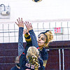 Greenbrier East's Nevaeh Wooding spikes over Oak Hill's Kendra Dempsey during Thursday evening action in Beckley. F. Brian Ferguson