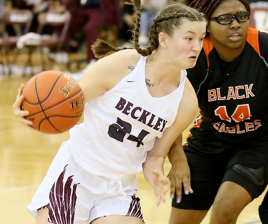 (Brad Davis/The Register-Herald) Woodrow Wilson's Liz Cadle starts a drive from the perimeter as South Charleston's Maliha Witten defends Wednesday night in Beckley.