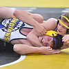 (Brad Davis/The Register-Herald) Nicholas County's Levi Brake takes on Berkeley Springs' Cole Morris in a 138-pound weight class final Friday night at the 73rd Annual State Wrestling Tournament in Huntington. Nicholas County's Brake won the match to advance to Saturday's championship finals.