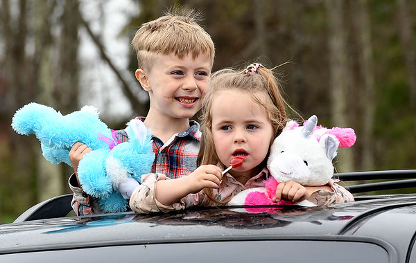 Greyson, 6, and Abiial Pack 4, hang out the sunroof of thier parents car during the Calvary Assembly of God church service Sunday morning to celebrate the Easter holiday with the congregations listening on the radio inside their vehicles due to the  COVID-19 pandemic. After the church service, a parade has held starting from the church's parking lot on Sunset Drive and ran through Harper Road, Robert C. Byrd Drive, Eisenhower Drive, and then ended at the Crossroads Mall parking lot.<br /> (Rick Barbero/The Register-Herald)