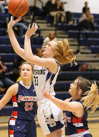 (Brad Davis/The Register-Herald) Shady Spring's Kierra Richmond drives to the basket as Independence's Alexis Clark defends Thursday night in Shady Spring.