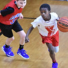 (Brad Davis/The Register-Herald) Beckley YMCA's Aminya Pankey cuts around Huntington's Brayden McRussell during 5th Grade Roundball Classic action Saturday afternoon at the YMCA of Southern West Virginia. Huntington won the game.