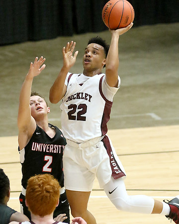 (Brad Davis/The Register-Herald) Woodrow Wilson's Richard Law drives to the basket as University's Kyle Smith defends during the final night of Big Atlantic Classic action Saturday at the Beckley-Raleigh County Convention Center.