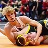 Liberty's Jesse Bradley looks to his coaches for advice during his 138-weight wrestling match against Greenbrier East's Chase Browning at the West Virginia Army National Guard Duals in Summersville on Friday. (Chris Jackson/The Register-Herald)