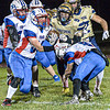 Midland Trail's Tyler Brasse, left, and Robert Ruffner converge on Shady Spring's Josh Goode during Friday evening action in Shady Spring. F. Brian Ferguson