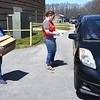 Donna Dunbar, cafteria manager, left and Emilie Hedinger, Raleigh County Schools liaison, distributes five days boxes of food at Beckley Straton Middle School in Beckley Wednesday afternoon. They handed out approximately 300 boxes to feed students during COVID-19.<br /> (Rick Barbero/The Register-Herald)