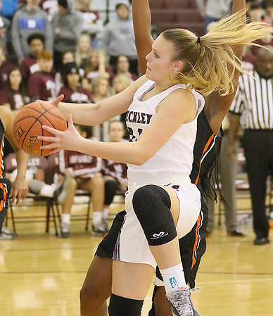 (Brad Davis/The Register-Herald) Woodrow Wilson's Olivia Ziolkowski drives to the basket as South Charleston's Mia Terry defends Wednesday night in Beckley.