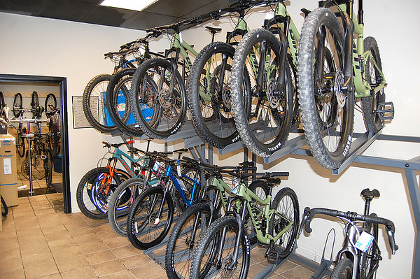 A rack of bicyles hangs at the business of Hammer Cycles in White Sulphur Springs. Hammer Cycles is a full service bicycle shop which includes pick up and delivery. <br /> Christian M. Giggenbach/for The Register-Herald)