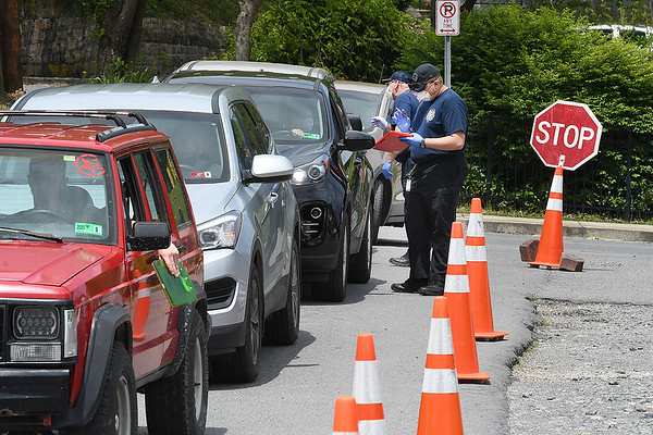 People line up in their vehicles providing information to get tested for COVID-19 outside the Mount Hope Fire Department Tuesday afternoon. This is a three day event the Fayette County Health Department is offering to help increase more testing. Everyone who got tested received a free pizza. Another testing site will be active Wednesday at Kilsyth Freewill Baptist Church from 3 p.m. to 7 p.m.  and Thursday at, Oak Hill High School freom. 3 p.m. to 7 p.m.<br /> (Rick Barbero/THe Register-Herald)