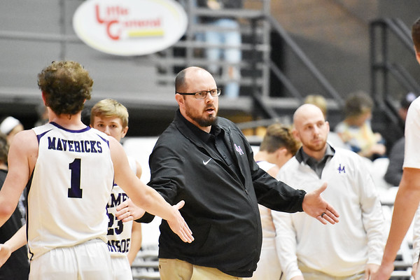 James Monroe's Head Coach Matt Sauvage with his team during a timeout of their Big Atlantic Classic basketball game against Bluefield in Beckley on Monday. (Chris Jackson/The Register-Herald)