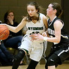 (Brad Davis/The Register-Herald) Wyoming East's Abby Russell moves along the perimeter as Westside's Makayla Morgan defends during Friday action at the New River Community and Technical College Shootout at the Beckley-Raleigh County Convention Center.