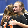 Emma Lindsey, left, and Gavin Pivot, of Summers Co., embrace each ofther after getting beat by Wirt Co., in the semi-final match of the Girls State Volleyball Tournament held at the Charleston Civic Center Wednesday morning. Summers Co. lost 3 sets to 1<br /> (Rick Barbero/The Register-Herald)
