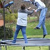 Michael Callaway, left, and his brother Ethan Callaway, playing basketball bouncing on a trampoline in their yard on Old Granview Road in Beaver.<br /> (Rick Barbero/The Register-Herald)