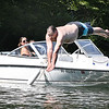Crystal Callaway, of Grandview, left, watches her husband Travis Callaway take a dive in  Lake Stephens from a friends boat Monday afternoon.<br /> (Rick Barbero/The Register-Herald)