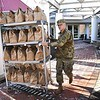 Dawson Murphy, W.Va. National Guard 115th Clarksburg unit, carts out bags of meals prepared by Tamarack in Beckley Monday morning. Tamarack joined together with Raleigh County and Monroe schools to provide two meals a day for five day to 1500 students from each county. 1500 meals were delivered to Monroe County Monday morning and additional 1500 meals will be prepared and delivered in Raleigh by the W.Va. National Guard to help continue feeding students during the coroanvirus crisis.<br /> (Rick Barbero/The Register-Herald)