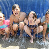 Gabby Epling, left, Chloe Dadson, Taylor Dove, Layla Weis and Isaiah Dodson, campers at Lake Stephens, cool off during a hot day in the Splash Pad at the Lake  <br /> (Rick Barbero/The Registewr-Herald)
