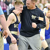 (Brad Davis/The Register-Herald) Greenbrier West's Marshall Clere gets kudos from coach Jeremy Tincher after defeating Fairmont Senior's Marko Tarley to advance to the 113-pound finals Friday night at the 73rd Annual State Wrestling Tournament in Huntington.