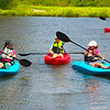 Erin Bennet, left. Lauren Harper, Anndalyn Bennet and Dalton Harper, enjoying their afternoon in kayaks located on Maria Bennet's pond, just outside of Fayetteville. <br /> Photo by, T.Paige Dalporto