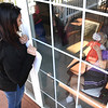 Melissa Blair watches her mom, Thelma James, kiss a doll through a window at Harper Mills Nursing Home in Beckley Saturday morning. Her mom is not allowed visitors inside because of the coroanvirus.<br /> (Rick Barbero/The Register-Herald)