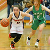 (Brad Davis/The Register-Herald) Summers County's Riley Richmond hustles up the court as she's persued by Charleston Catholic's Claire Mullen defends Wednesday night in Hinton.