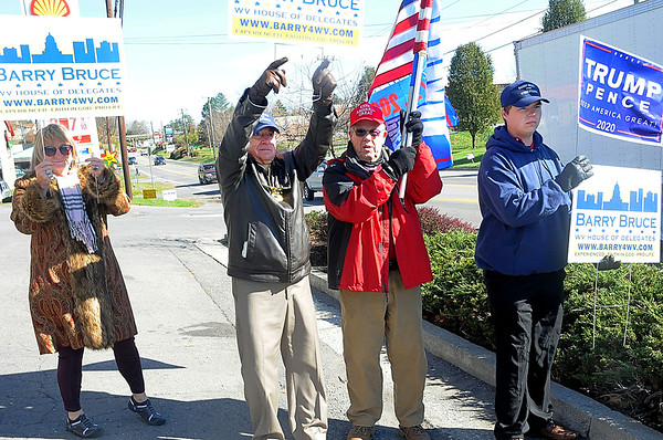 Lisa McCoy, left, Barry Bruce, Dave Marshall Jr., Trey Ewing out campaigning on election day in Lewisburg. Barry Bruce is running for House of Delegates.<br /> T. Paige Dalporto/for the Register-Herald