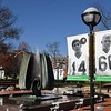 Posters of everyone that was killed in the Marshall plane crash fifty years ago are on display near the Memorial Marshall Memorial Fountain in Huntington.<br /> (Rick Barbero/The Register-Herald)