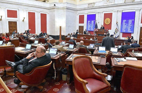 (Brad Davis/The Register-Herald) Senators work through an evening session during the final day of the state's regular legislative session Saturday in Charleston.