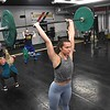 Sarah Daniel, of Glen Daniels, center, and other members, workout at Redline Fitness in Beckley. Redline was closed down dur to COVID-19 and reopened on Monday, May 18.<br /> (Rick Barbero/The Register-Herald)