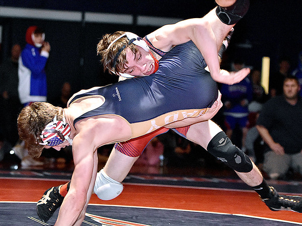 (Brad Davis/The Register-Herald) Independence's Bryce Perdue takes on Shady Spring's Josh Goode for the Class AA, Region 3, 126-pound weight class championship Saturday night in Coal City. Indy's Perdue won the match.