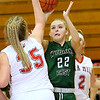 (Brad Davis/The Register-Herald) Wyoming East's Kayley Bane drives and shoots as Oak Hill's Savannah Holbrook defends Thursday night in Oak Hill.