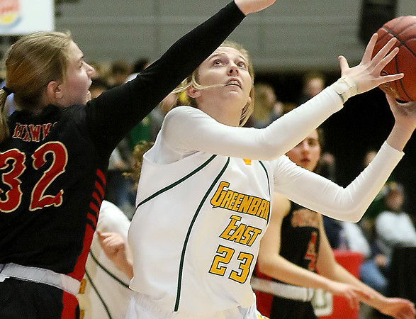 (Brad Davis/The Register-Herald) Greenbrier East's Haley McClure drives to the basket as University's Abbie Coen defends during the final night of Big Atlantic Classic action Saturday at the Beckley-Raleigh County Convention Center.